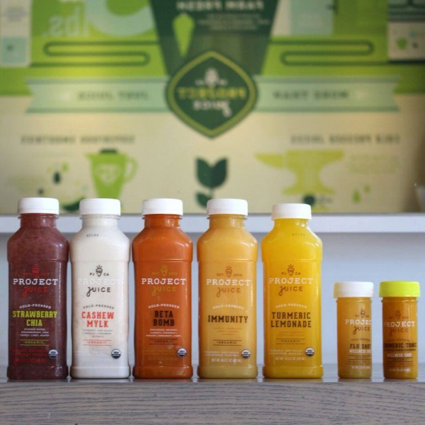 Line up of different juice options from Project Juice including strawberry chia, cashew milk, beta bomb, immunity, and tumeric lemonade