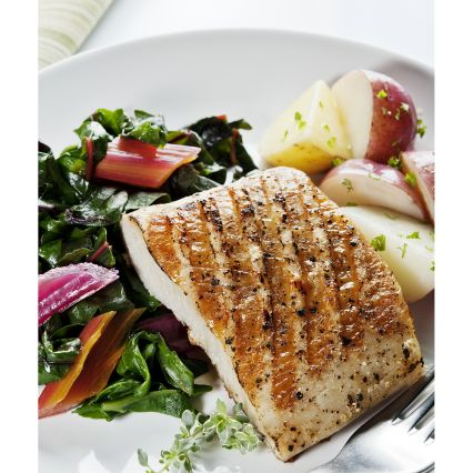 Seafood on the Grill image of grilled fish on salad plate with roasted potatoes
