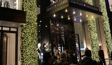 Tommy Hilfiger flagship store on fifth avenue with string lights going up tall columns