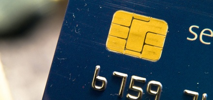 Close-up of a credit card's security chip.