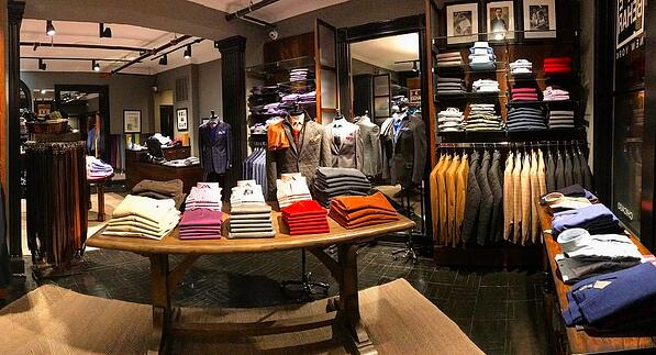 Men's clothing on display inside a Ike Behar store.