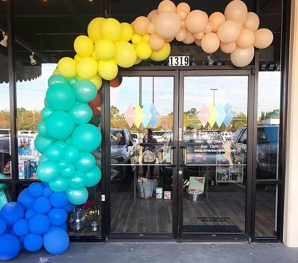 rainbow balloon arch over a doorway