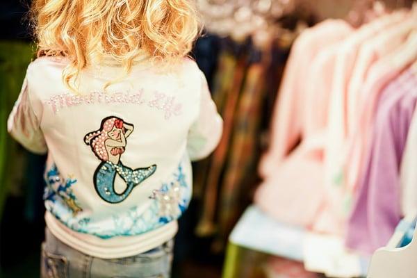 young girl wearing a mermaid life rhinestone jacket