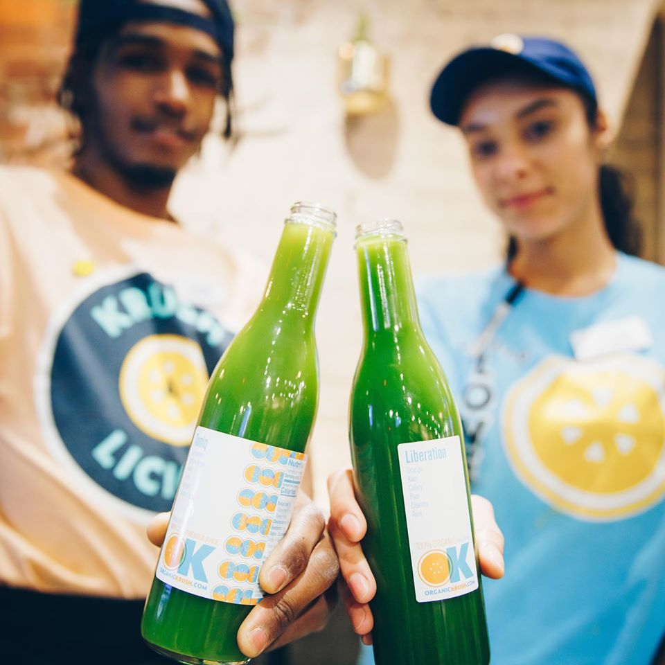 Organic Krush Staff Holding Juices