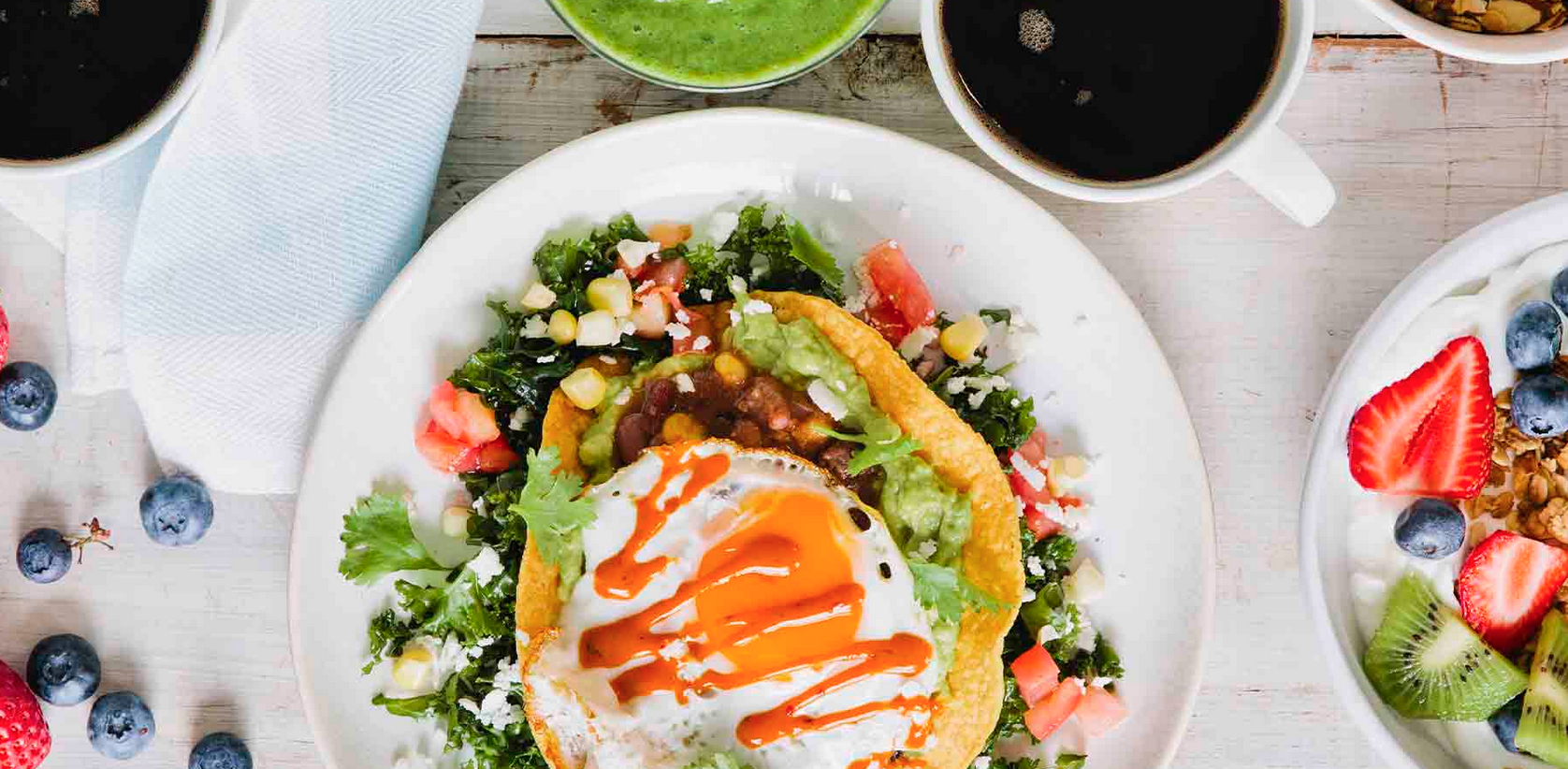 BGood brunch display including a sunny side up egg over a taco bowl