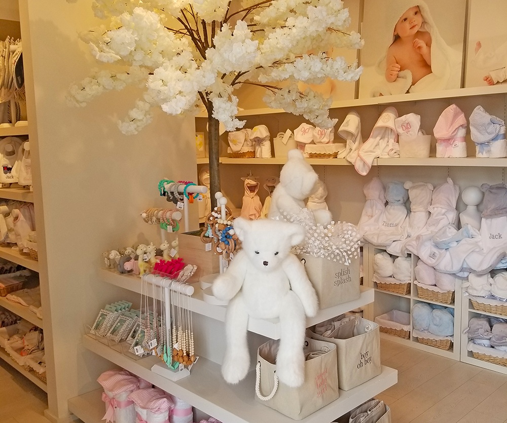 inside of Baby Braithwaite store with stuffed bears and jewelry on display