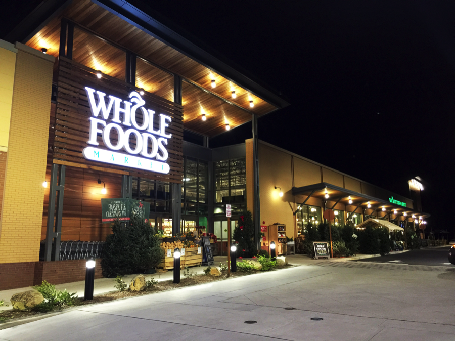 Whole Foods storefront at night.