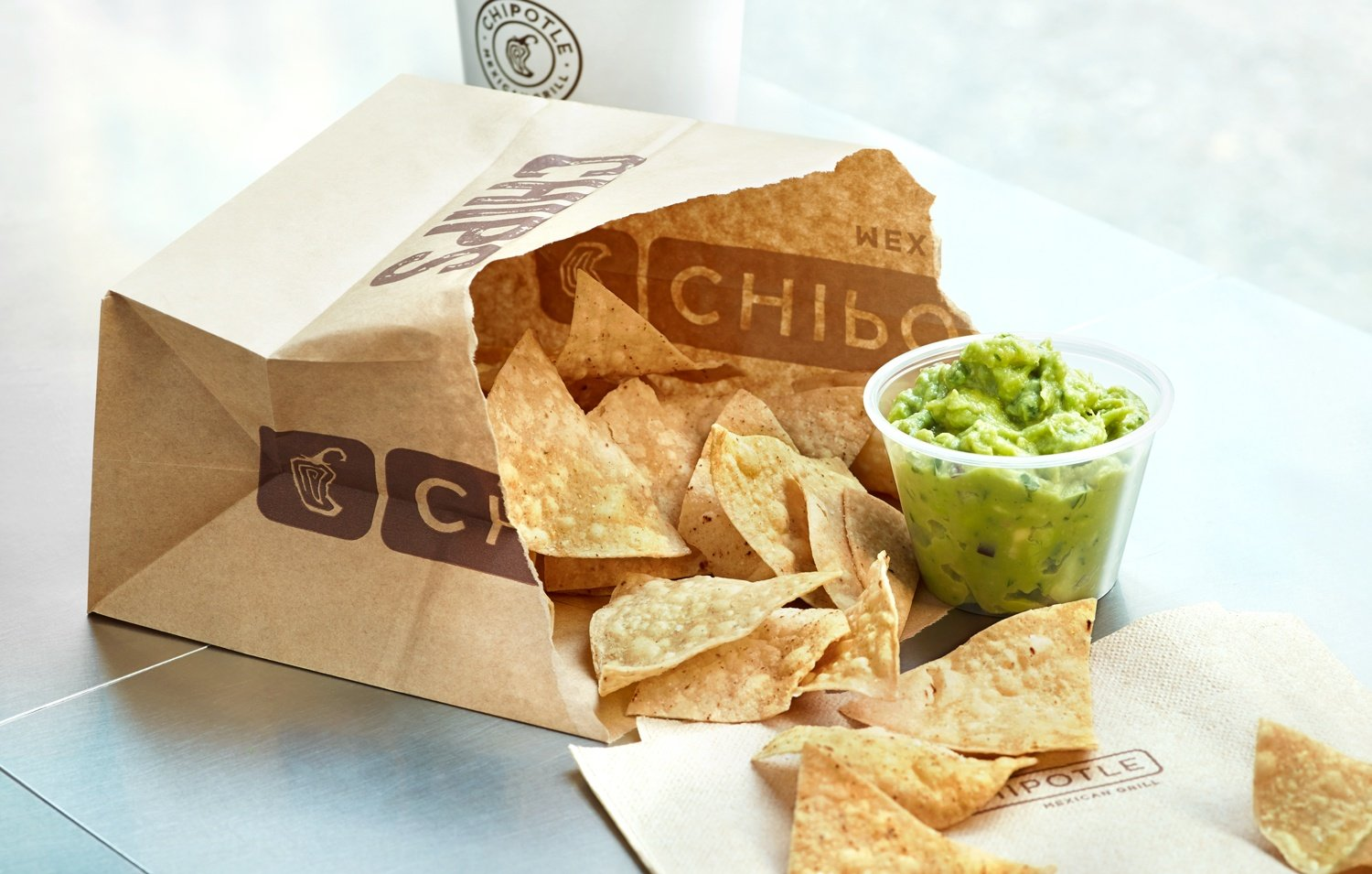 Chipotle chips and guacamole in brown bag