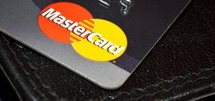 Close-up of a MasterCard logo on a credit card.