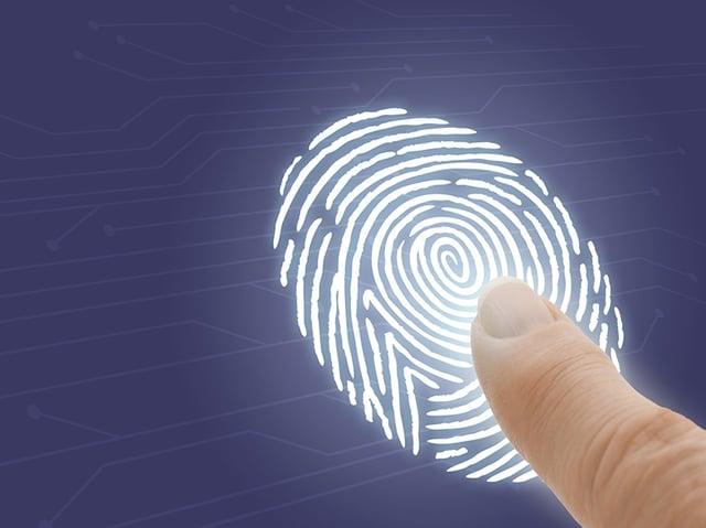 A finger pressing on a large computer-generated fingerprint.