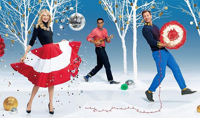 Target models having fun in a winter wonderland setting, with one of the models wearing a skirt that resembles Target's logo.