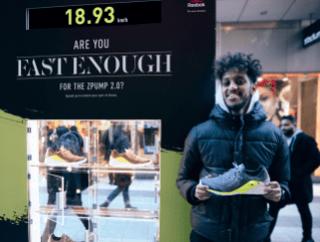 Shopper holding a shoe he won.