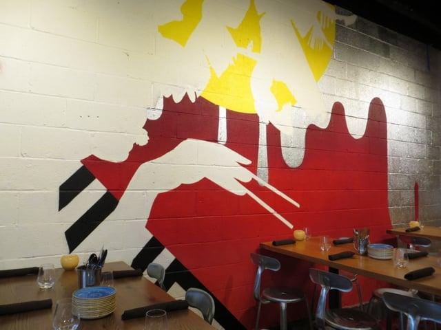 wall art inside the restaurant of a silhouetted man holding chopsticks