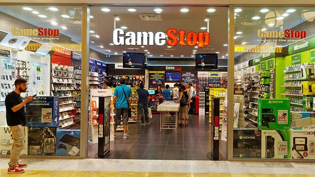 Entrance to a GameStop store inside a mall.