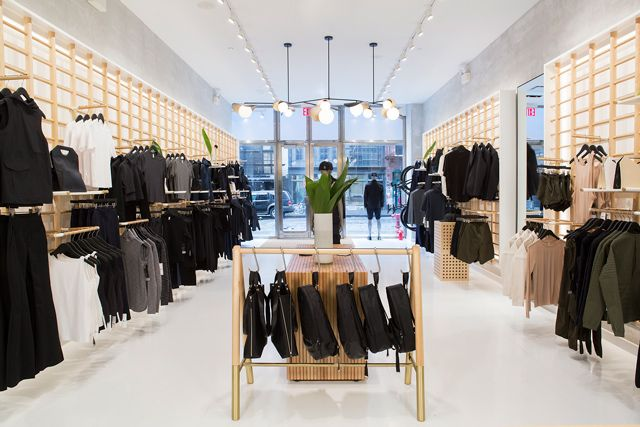 inside Lululemon store with black and white clothing hung on walls