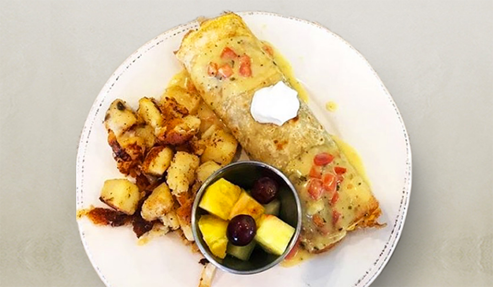 omelette from First Watch with side of potatoes and fruit