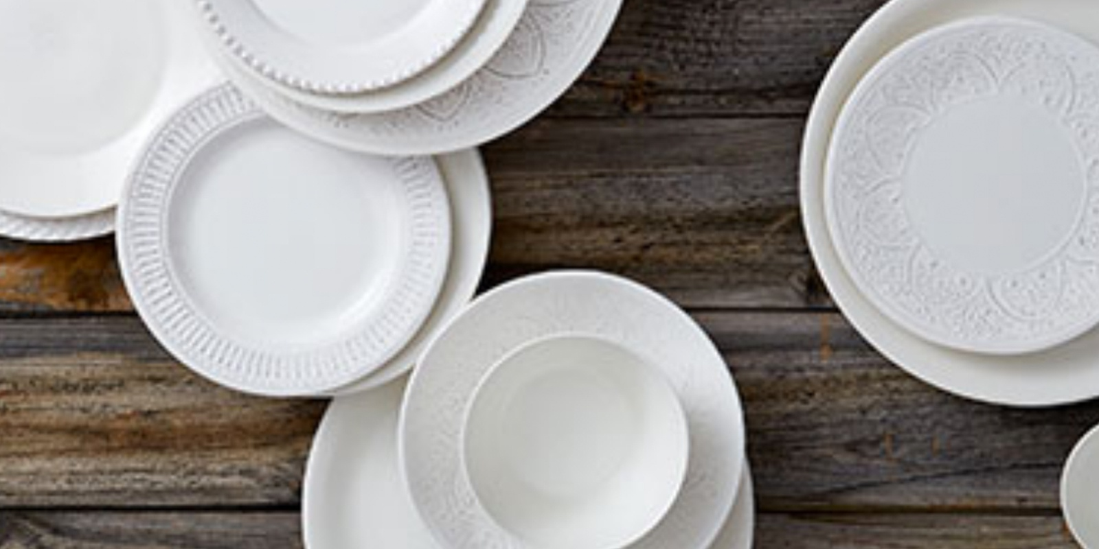 display of white dishes from HomeSense