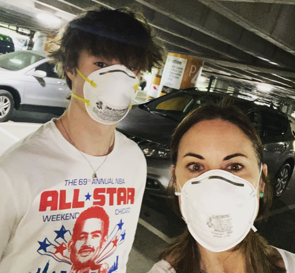Leslie Mintz and son in masks