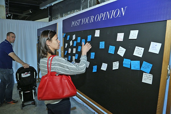 A woman posting a written opinion on an opinion board.