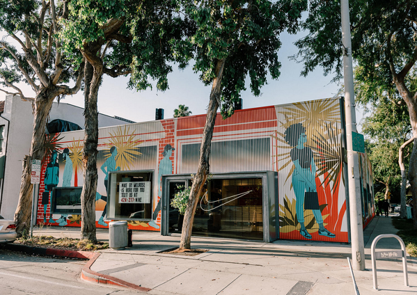 Murals of people and bright colors on the Nike storefront in Melrose.