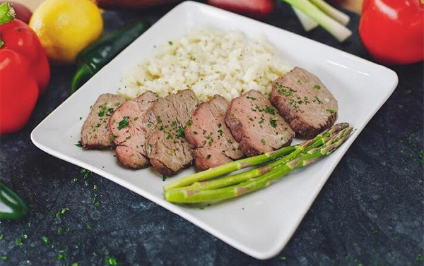Plate of asparagus and beef.