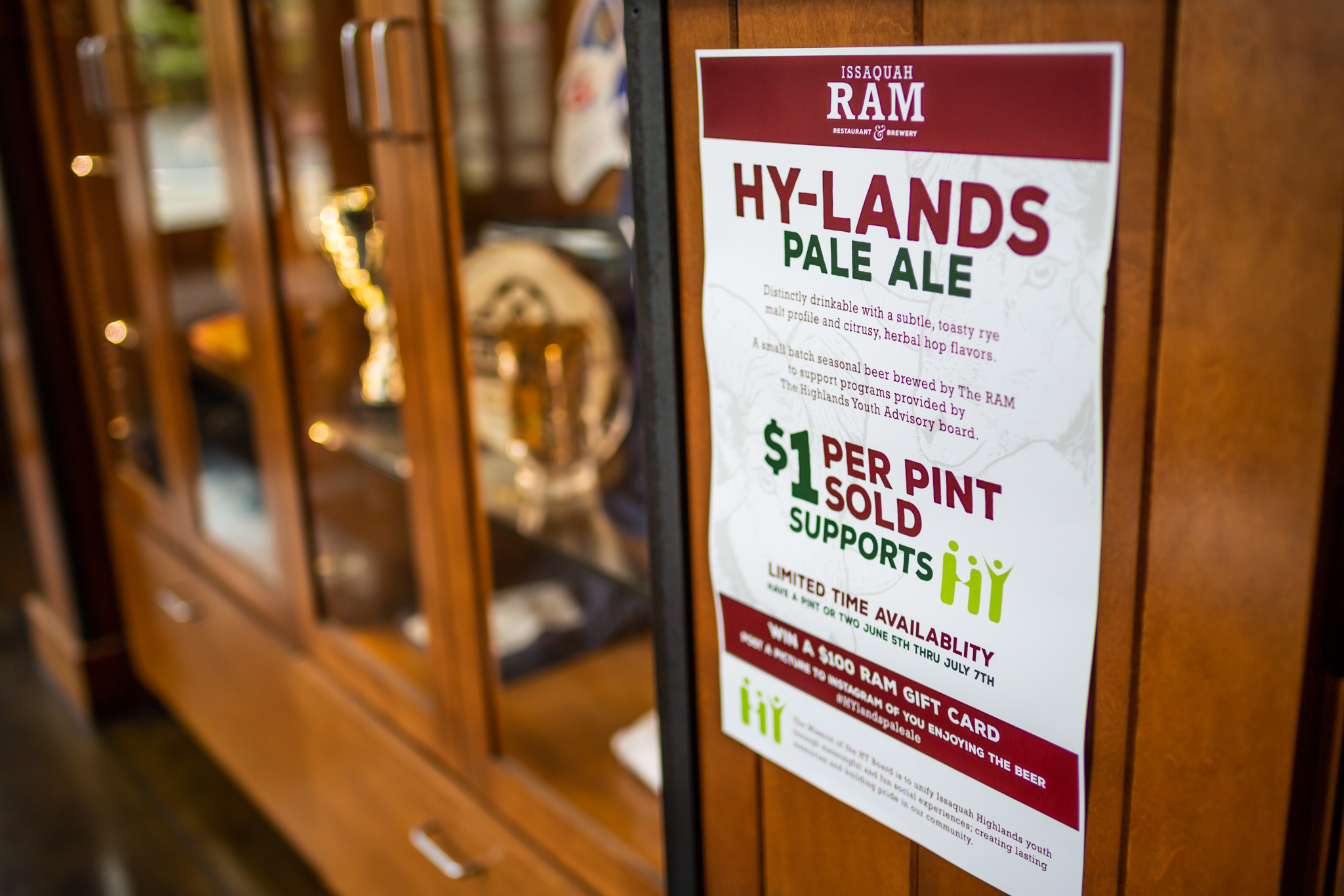 Sign on wall at RAM for Hy-Lands Pale Ale charity donation