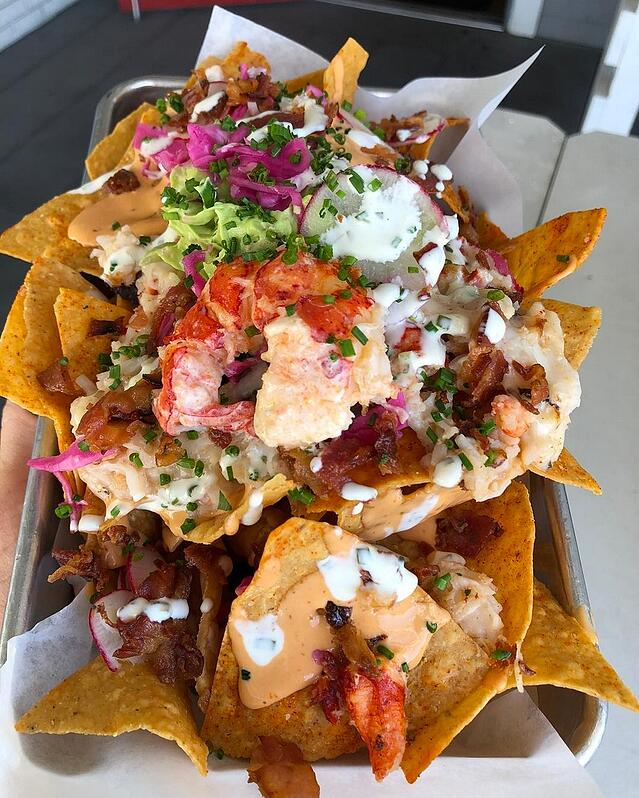 Nachos with lobster on top.