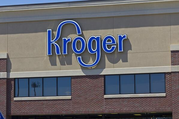 Close-up of Kroger logo on storefront.
