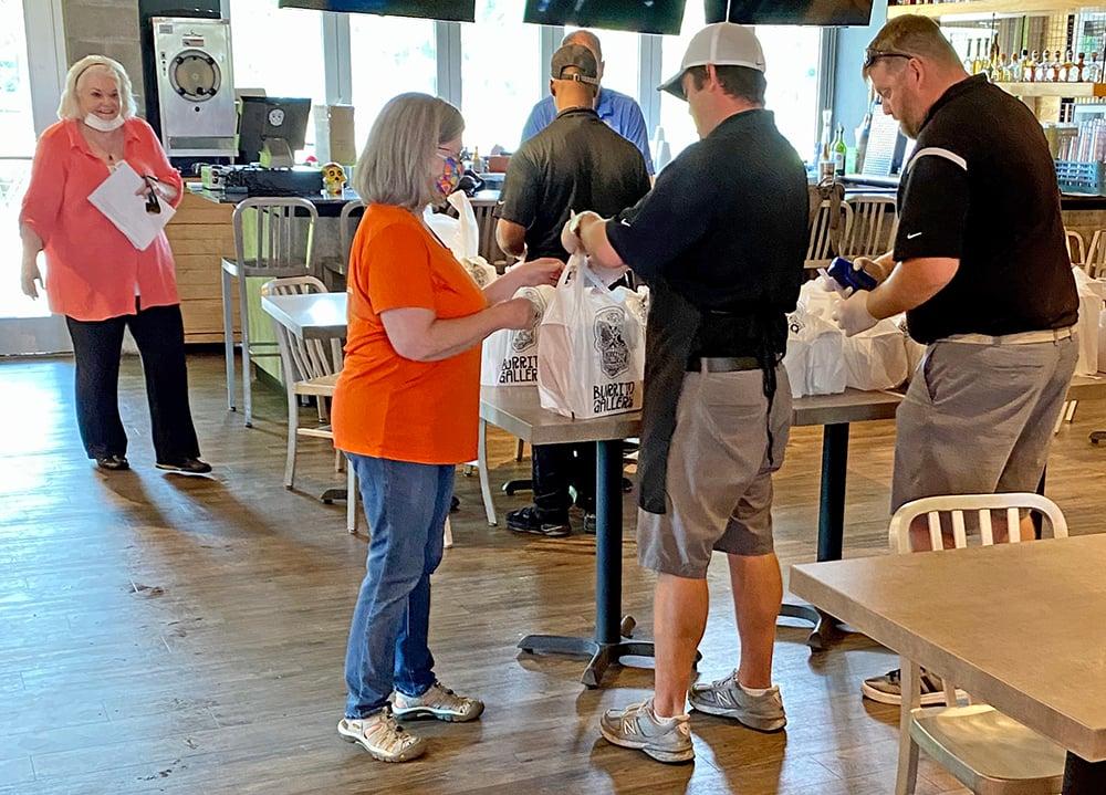Regency volunteers assisting Burrito Gallery managers