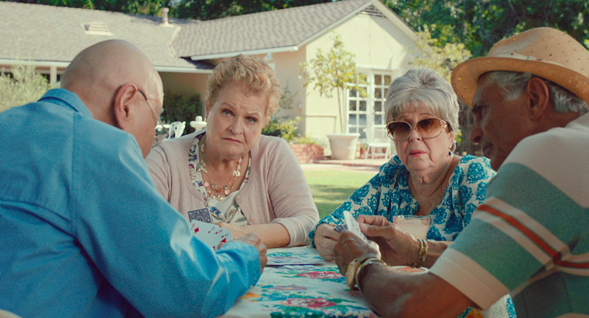 Image from a Mcdonald's commercial of two grandmas and two grandpas playing cards in a yard.