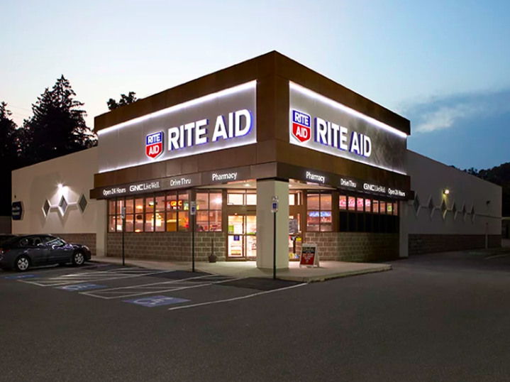 Rite Aid storefront at dusk