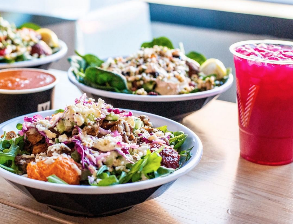 fresh salads and a bright pink iced drink