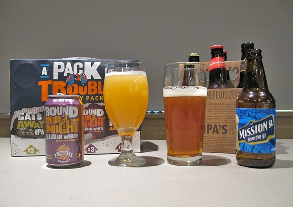 A can, bottle and two draft beers of Walmart's new line of craft beer