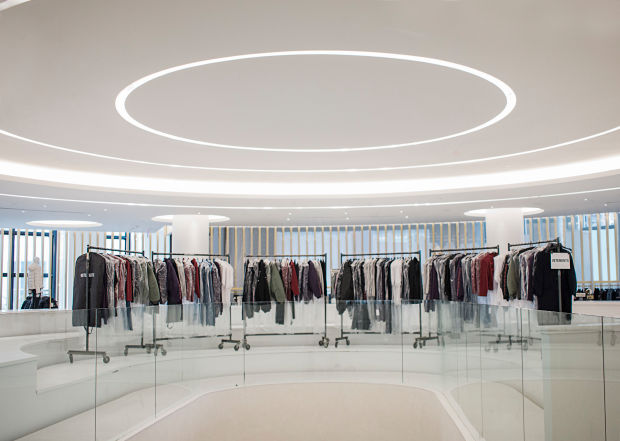 Racks of clothes inside Saks Fifth Avenue's new store.