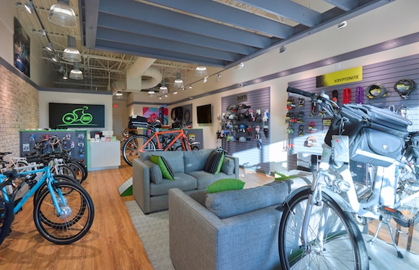 Various bikes and gear on display inside Electrobike