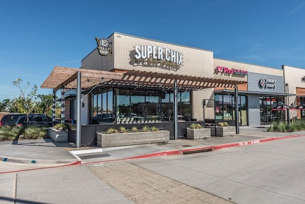 Outside shot of Super Chix in a shopping center.