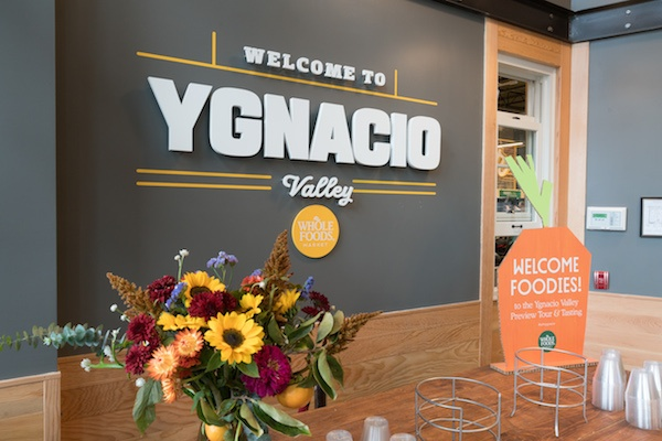 "Whole Foods signage on a wall that reads, ""Welcome to Ygnacio Valley."""