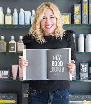 "Alli Webb in a Drybar holding an open book that reads, ""Hey, good lookin."""
