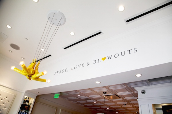 "Inside the new Drybar with ""Peace, love and blowouts"" painted on the wall."
