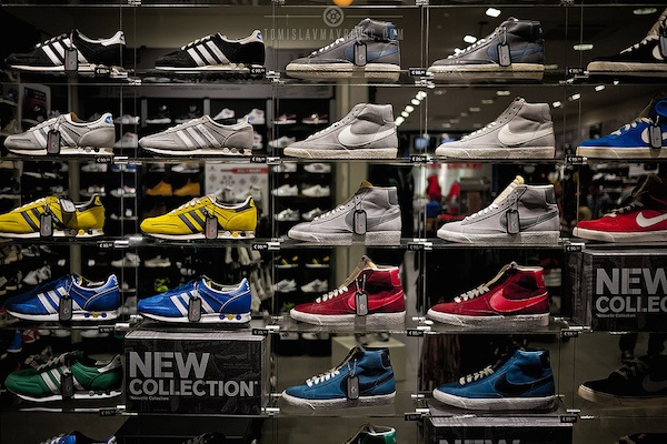 Various Nike and Adidas shoes on display.