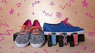 Two pairs of shoes inspired by the '90s, with different lipstick next to them and pink squiggly shapes drawing around everything.
