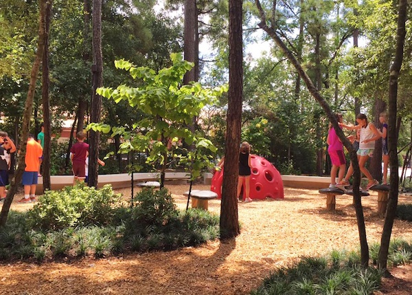 Children playing in the playground at Panther Creek Village.