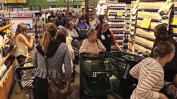 Whole Foods Grand Opening with aisles filled with customers and their carts