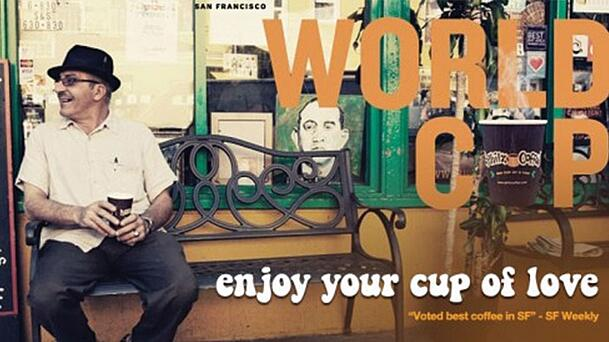 "vintage looking image of a man sitting on a bench with a fedora on, holding a cup of coffee. there's a quote on the image that says ""world cup. enjoy your cup of love."""
