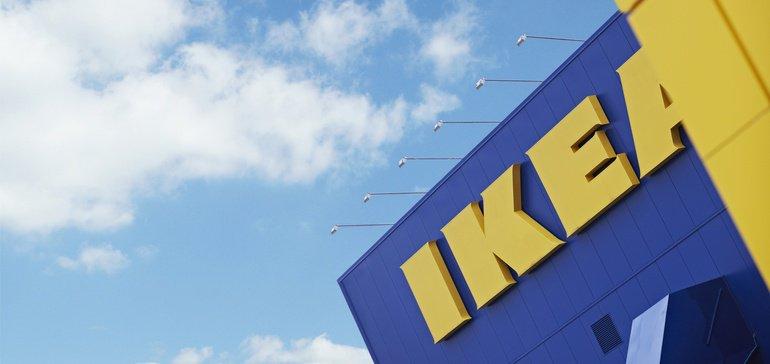 Close-up of IKEA logo on storefront.
