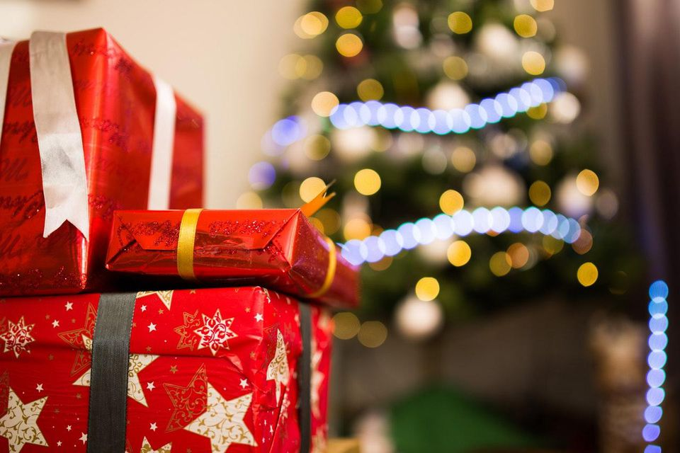 wrapped christmas presents with a tree in the background