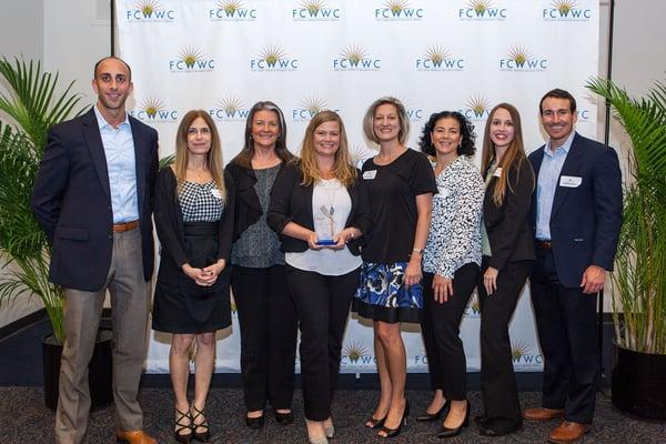 Matt Mueller, Lisa Buchillon, Jeannie Gilbert, Reese Dowell, Jamie Conroy, Vinna Elabu, Katie Arrington and Holden Kortus holding an award