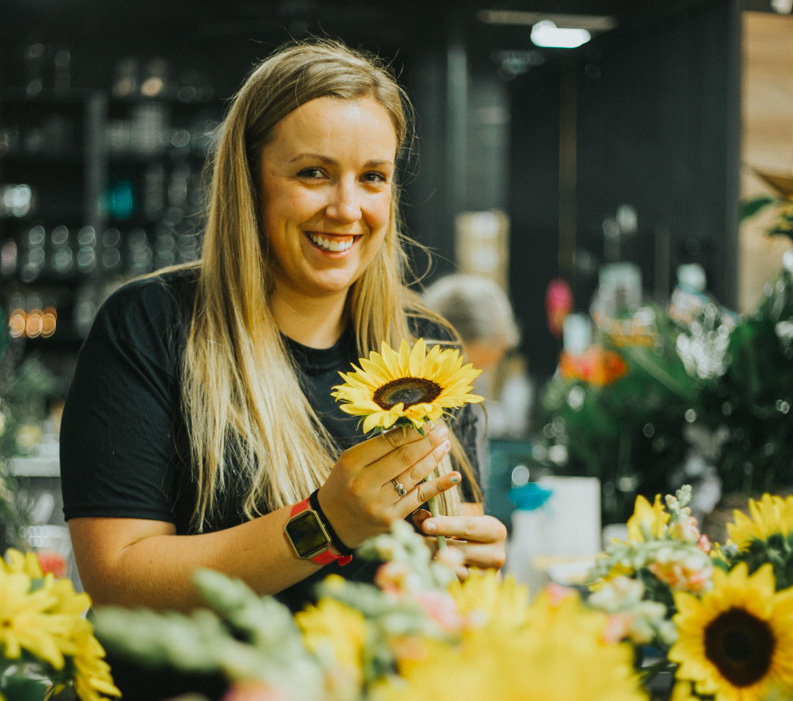 In Bloom Florist Holding Sunflower