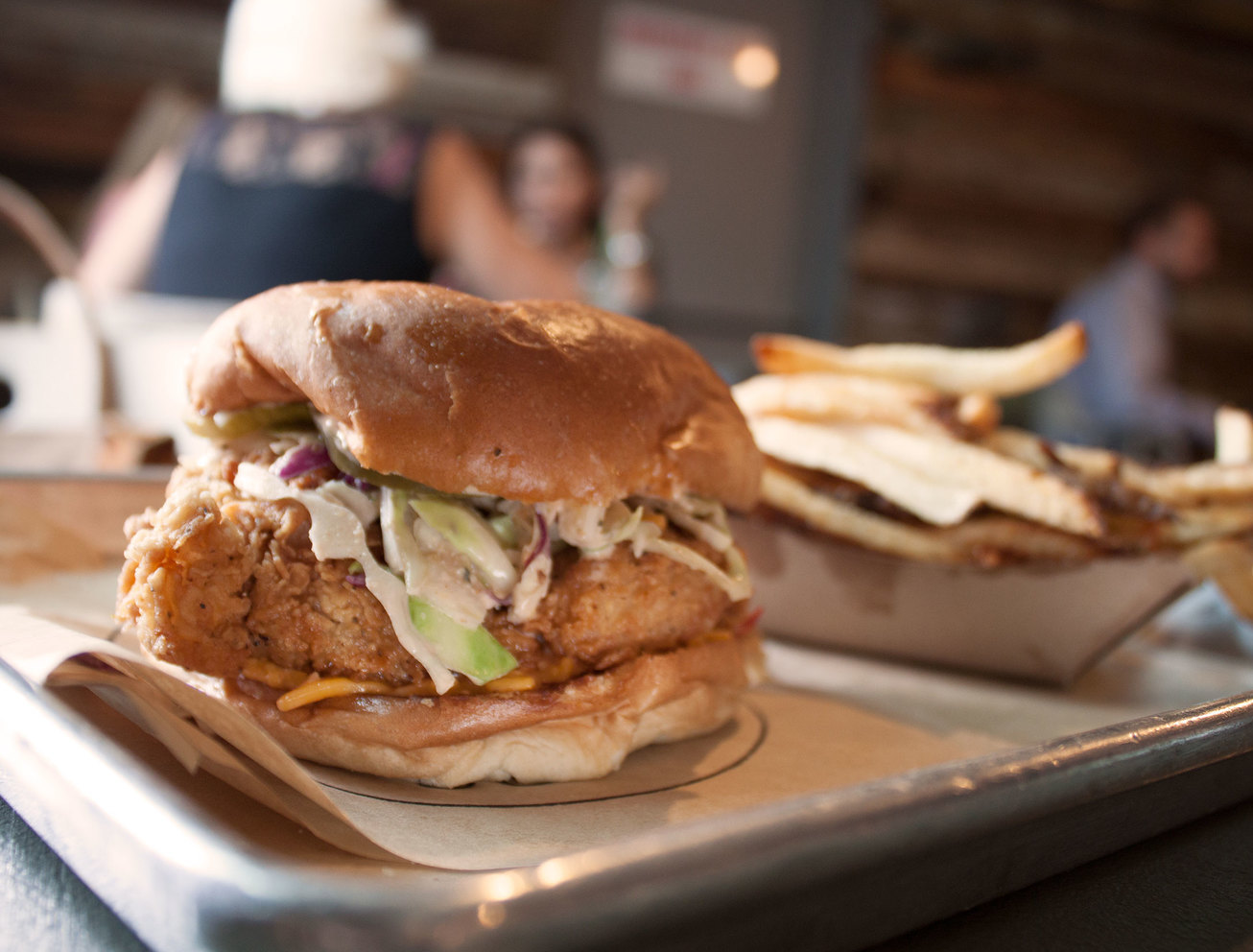 metal tray with fried chicken sandwich and fries