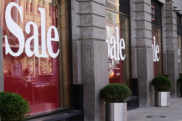 Sale signs on a storefront.